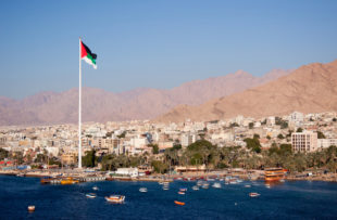 View to the city of Aqaba from the gulf of Aqaba . Aqaba is the capital city of Jordan.