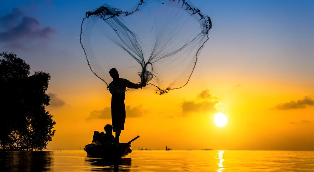 Casting a silhouette at sunset over Lake Victoria, 10 days in Uganda