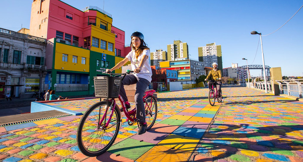 take a bike tour through the colourful district of La Boca on your trip to Argentina